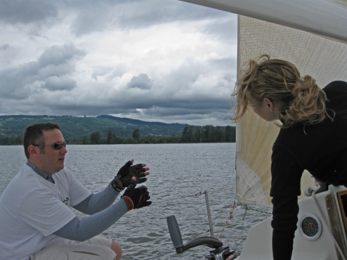 Rich explains the basics of genoa trim to first-time crew member Rebecca.